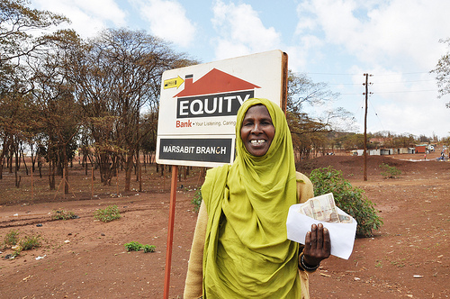 Sake Dabasso Halake with her recent livestock insurance payout, which was made in northern Kenya's Marsabit District following the great drought that afflicted the Horn of Africa in the latter half of 2011 (photo credit: Jeff Haskins/Burness Communications).